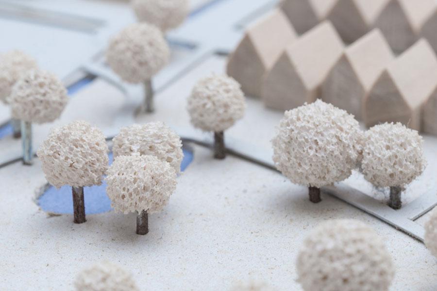 Foto zeigt ein Modell einer geplanten Wohnsiedlung   Gutachten und Planung
