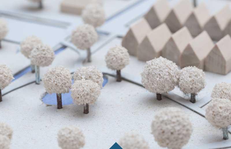 Foto zeigt Modelllandschaft mit Häusern, Wegen und Bäumen